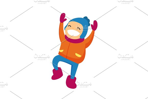 Caucasian Boy In Winter Clothing Jumping Outdoors