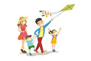 Young caucasian white family playing with a kite.