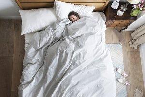 Caucasian woman on bed sleeping
