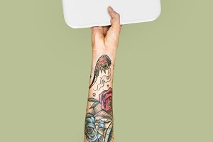 Tattooed hand holding weight (PSD)