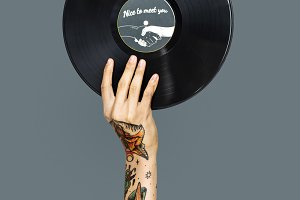 Tattooed hand holding vinyl (PSD)