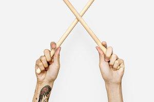 Hands holding drumsticks (PSD)