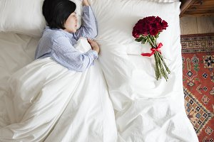 Woman sleeping and bouquet of flower