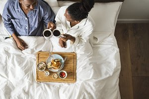 African American couple in bed