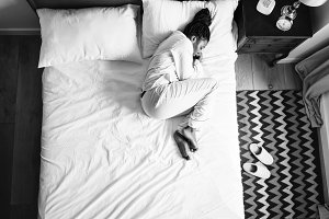 Woman sleeping on bed alone