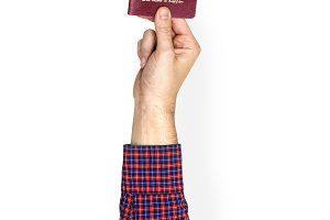 Hand holding passport (PSD)