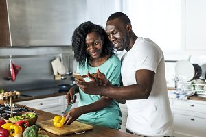 Black couple cooking in the kitchen