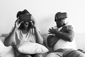 Black couple playing vr handset