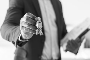 Real estate agent handing the key