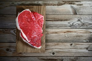 meat fillet on wooden background
