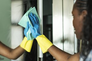 Black woman doing house chores