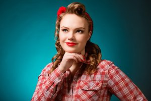 Pretty pinup girl in retro vintage 50's style