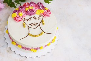 Festive cake with cream flowers and