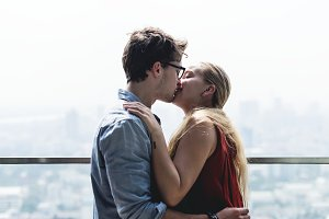 Couple kissing cityscape background