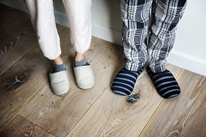 Closeup of couple wearing slippers