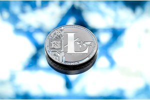 coins litecoin, against the background of the Israeli flag, concept of virtual money, close-up. Conceptual image