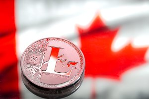 coins litecoin, against the background of Canada flag, concept of virtual money, close-up. Conceptual image.