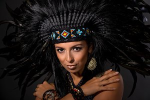 Portrait of young woman in costume of  American Indian