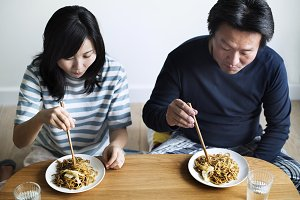 Asian couple eating noodles