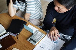 Asian couple planning financial