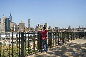 Tourist taking photos of Manhattan