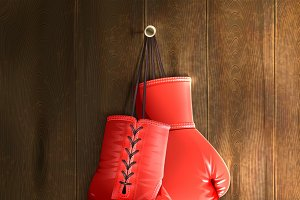 Red boxing gloves on wall