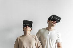 White couple experiencing VR