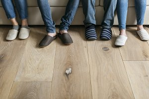 Pairs of legs with wooden floor