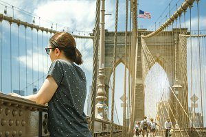 Woman in Brooklyn Bridge in New York