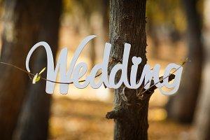 Word wedding on a beautiful blurred