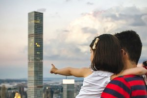 Man and girl looks Manhattan skyline