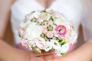 Wedding bouquet in hands of the brid