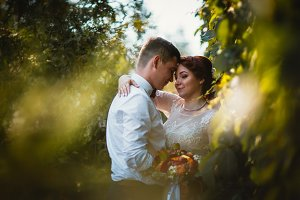 The bride and groom in the foliage o