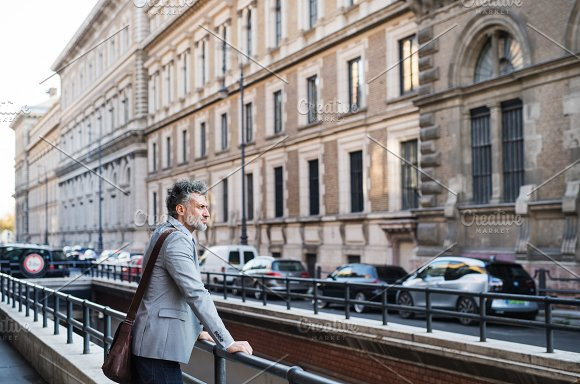 Mature Businessman Standing In A City
