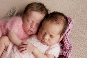two twins newborn sleeping