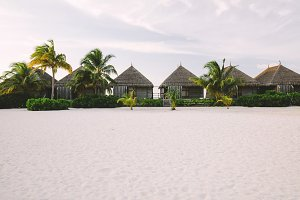 Exotic cabins on a sandy beach with