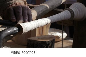 Craftsman turning wood on a vintage