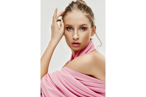 Beauty face of young fashion model woman with bright eyes and lips