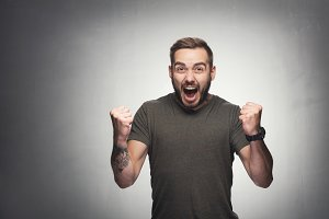 Excited man on grunge background