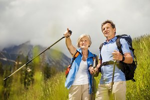 Senior couple of tourists in the mountains.