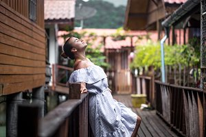 beautiful girl standing on the pier in fisherman's Cove, the color of Thai village