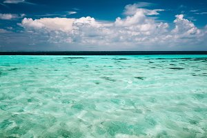 Clear ocean water and a cloudy blue