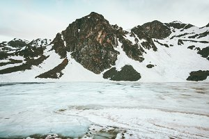 Snowy mountains and frozen lake