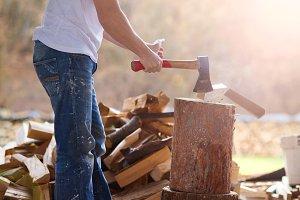 Man cutting down wood.