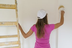 Woman working in new house.