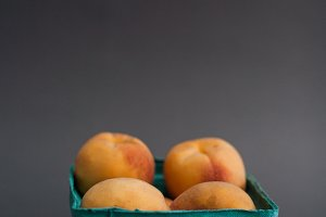 Peaches on gray background