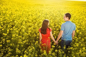 Young couple in field.
