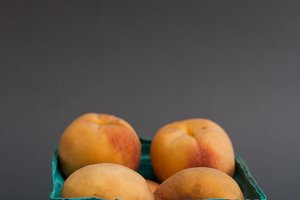 Peaches on gray background 2