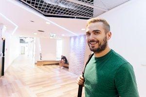 Sportive man in a modern gym interio