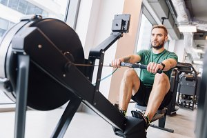 Active athlete man doing rowing work